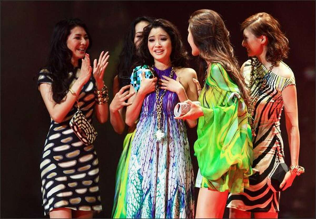 Newly selected 2009 Miss Universe Japan Emiri Miyasaka, center, celebrates with other contestants during the 2009 Miss Universe Japan Final,