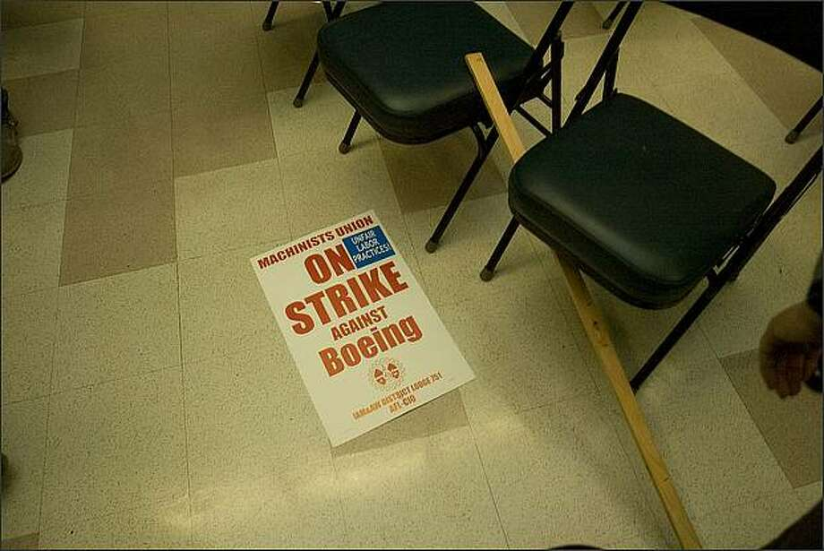 A broken strike sign lays on the floor of Union headquarters after it was announced that the union was giving Boeing an additional 48 hours. Members of the International Association of Machinists and Aerospace Workers turned down Boeing's latest contract off and voted to go on Strike but Boeing offered to continue talks and the Union agreed to give them 48 hours to come up with a better offer at Seattle Union Hall. Photo: Grant M. Haller, Seattle Post-Intelligencer