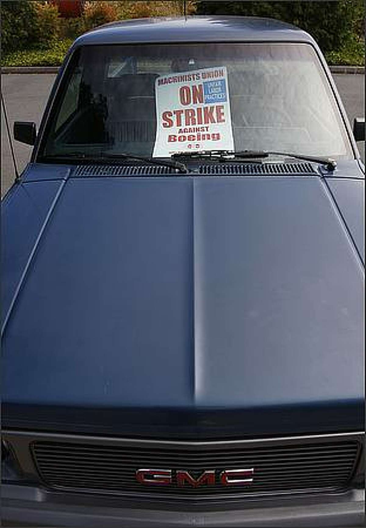 A strike sign is placed in the window of a Boeing employee's pickup truck in the parking lot of Union Hall District Lodge in Everett. (Brad Vest/Seattle P-I)
