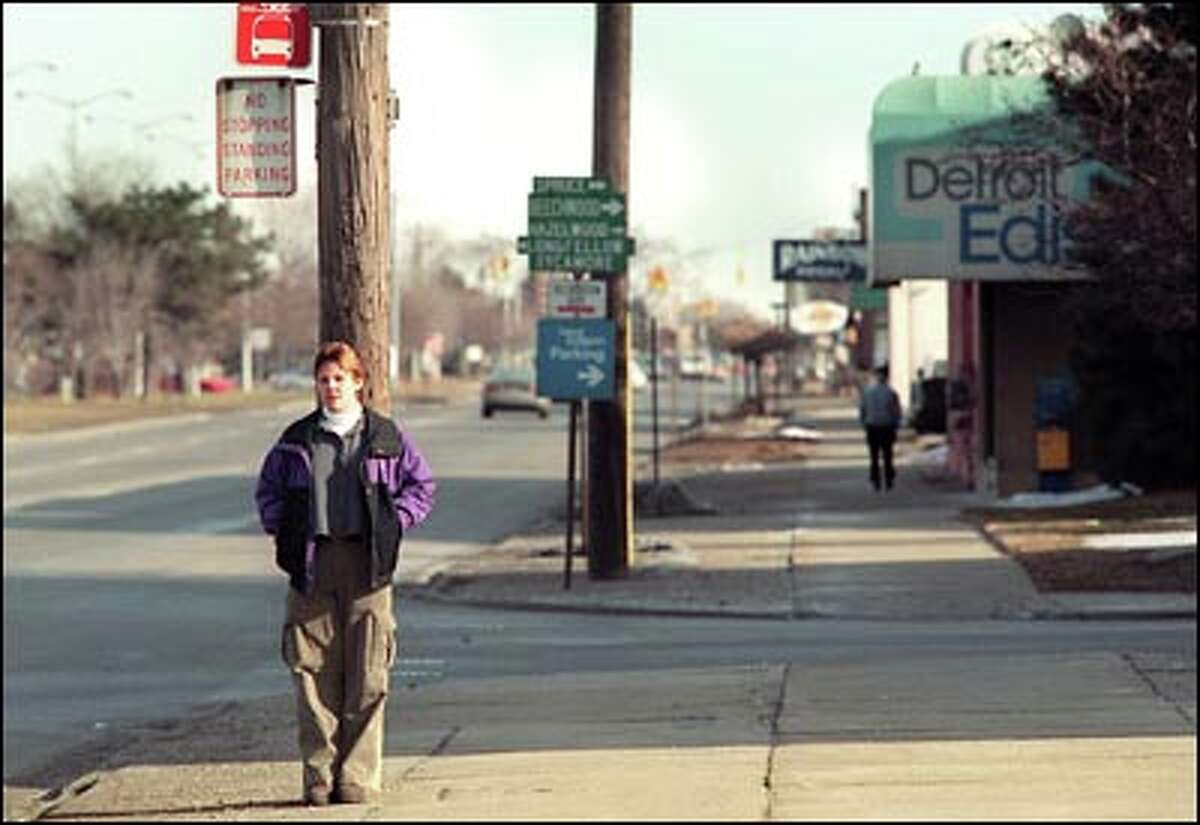In February, Tina waits for a bus after her methadone treatment at a Detroit clinic. She has since returned to Seattle and is still on methadone.
