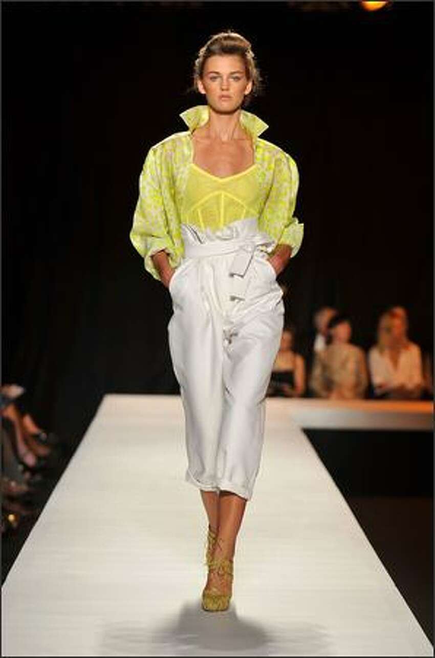 A model walks the runway at the Isaac Mizrahi Spring 2009 fashion show during Mercedes-Benz Fashion Week at Hammerstein Ballroom in New York City.