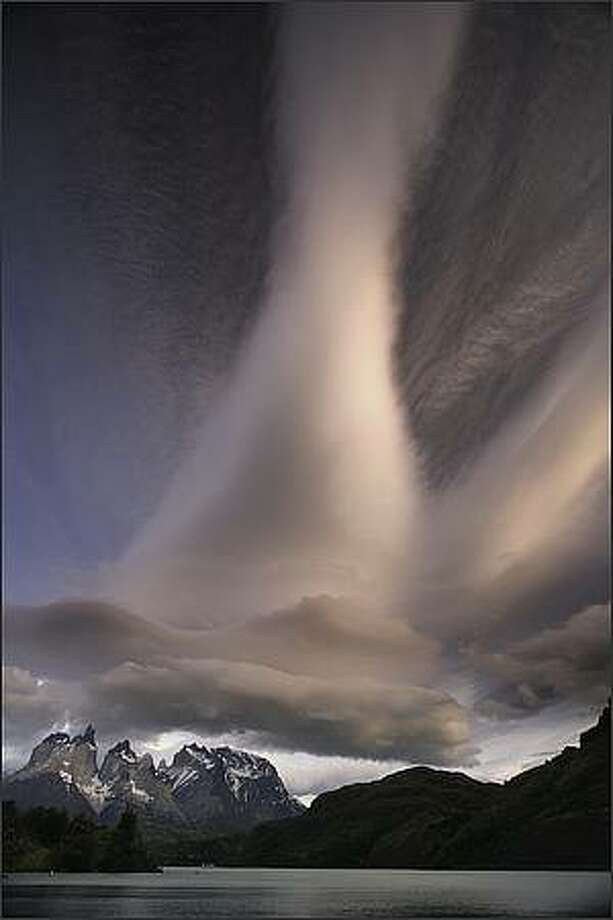 Lenticular cloud over Cuernos del Diablo, Torres del Paine National Park, Chile. Art Wolfe / Edge of the Earth Productions, LLC