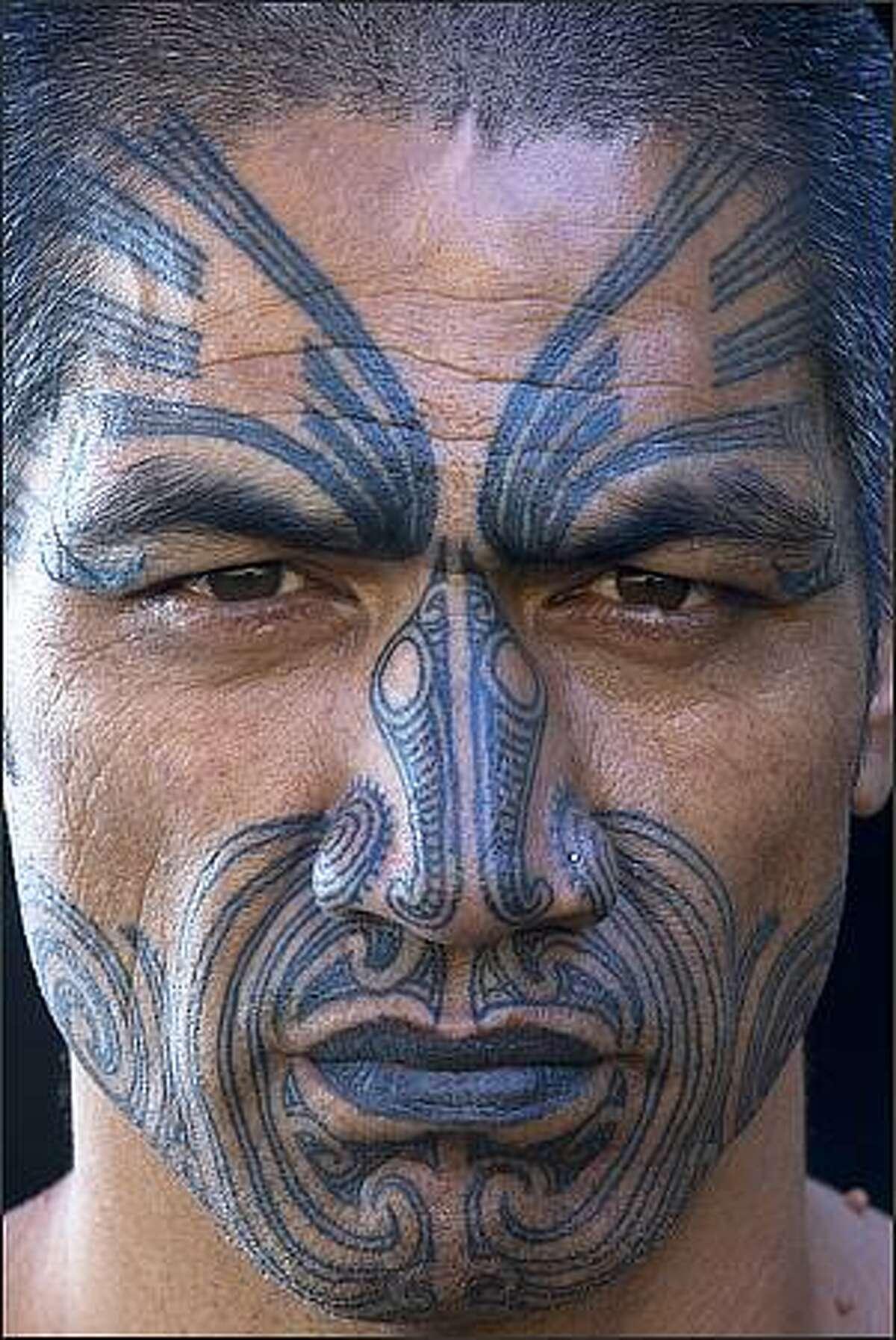 Maori dancers, New Zealand. Art Wolfe / Edge of the Earth Productions, LLC