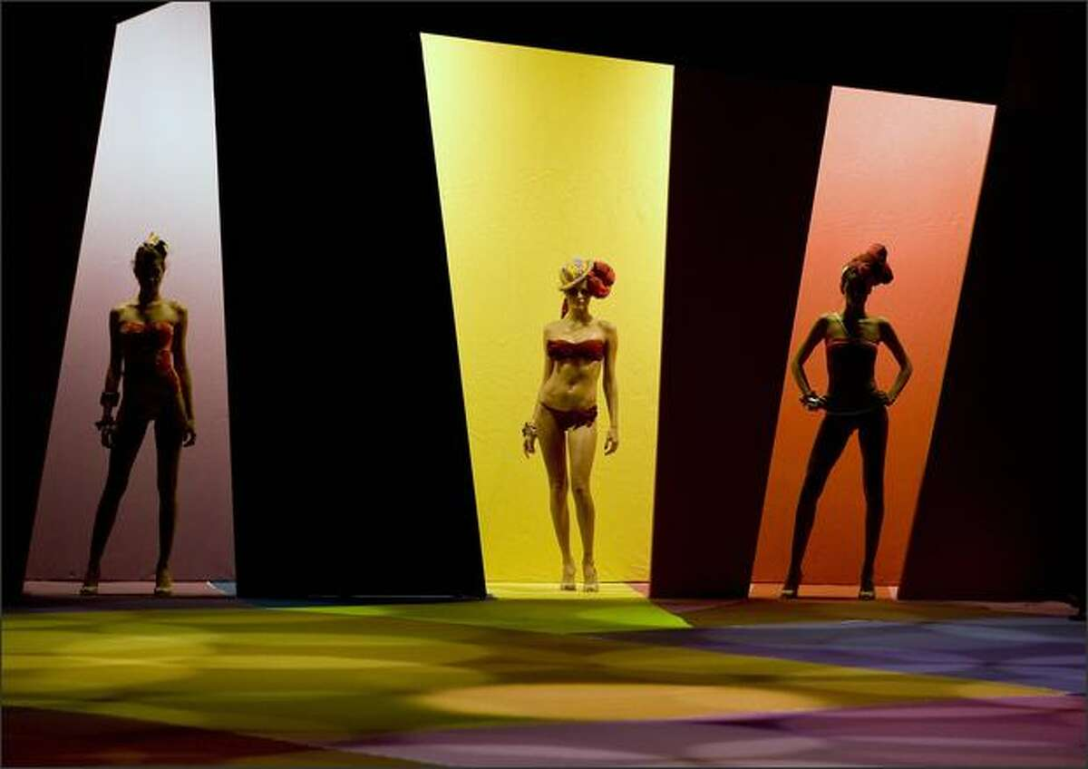 Brazilian models display creations by designer Salinas during Rio Fashion Week, in Rio de Janeiro's harbor, on Saturday, June 6, 2009.