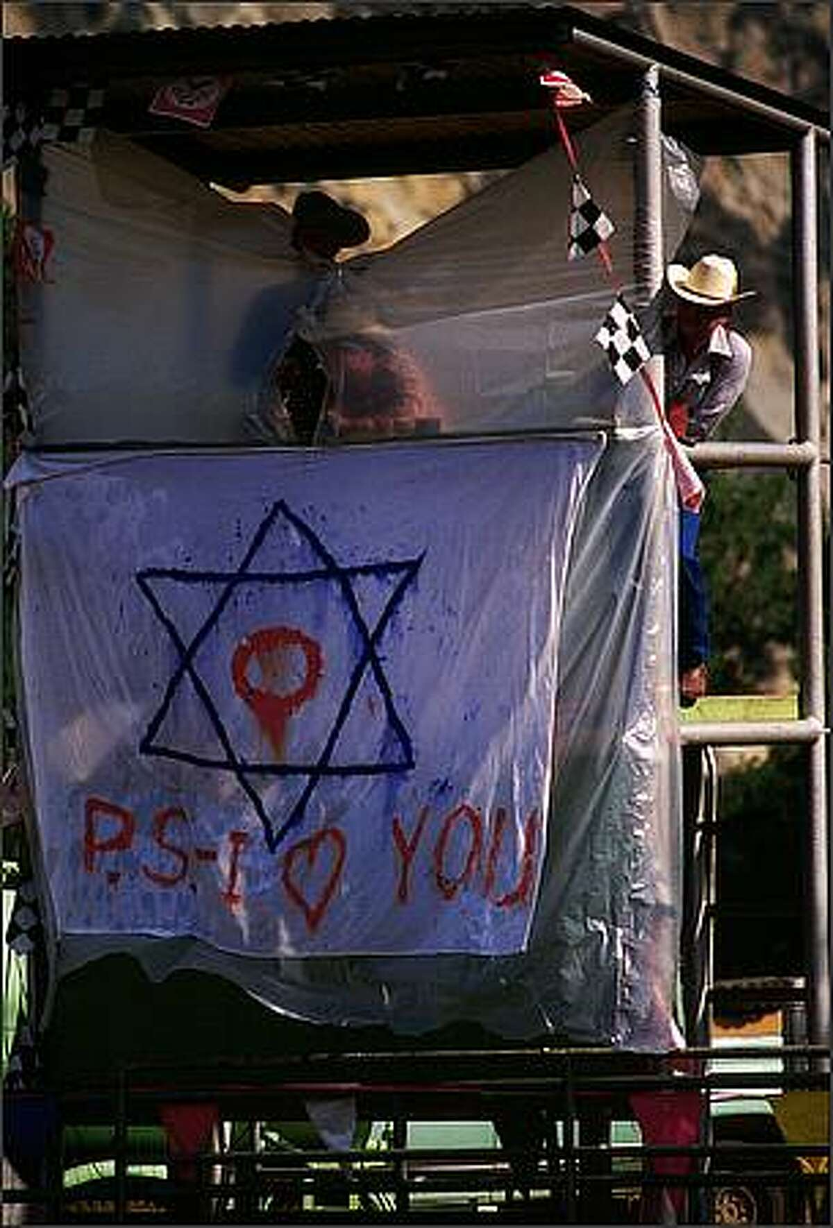 May 9, 1989, Santa Ynez Valley, California: In San Marcos Camp, the Jewish Star of David is prominently displayed on the judge's stand during El Rodeo, the Ranchero cowboy skills competition. The stand is frequently pelted by participating members who disagree with the judges' calls. To protect the judges, it is covered with a thick plastic. The Star of David has been positioned as a distracting target. Photo by: Tomas / Polaris