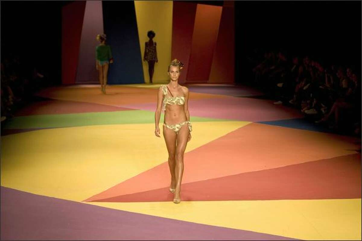 Brazilian models display creations by designer Salinas.
