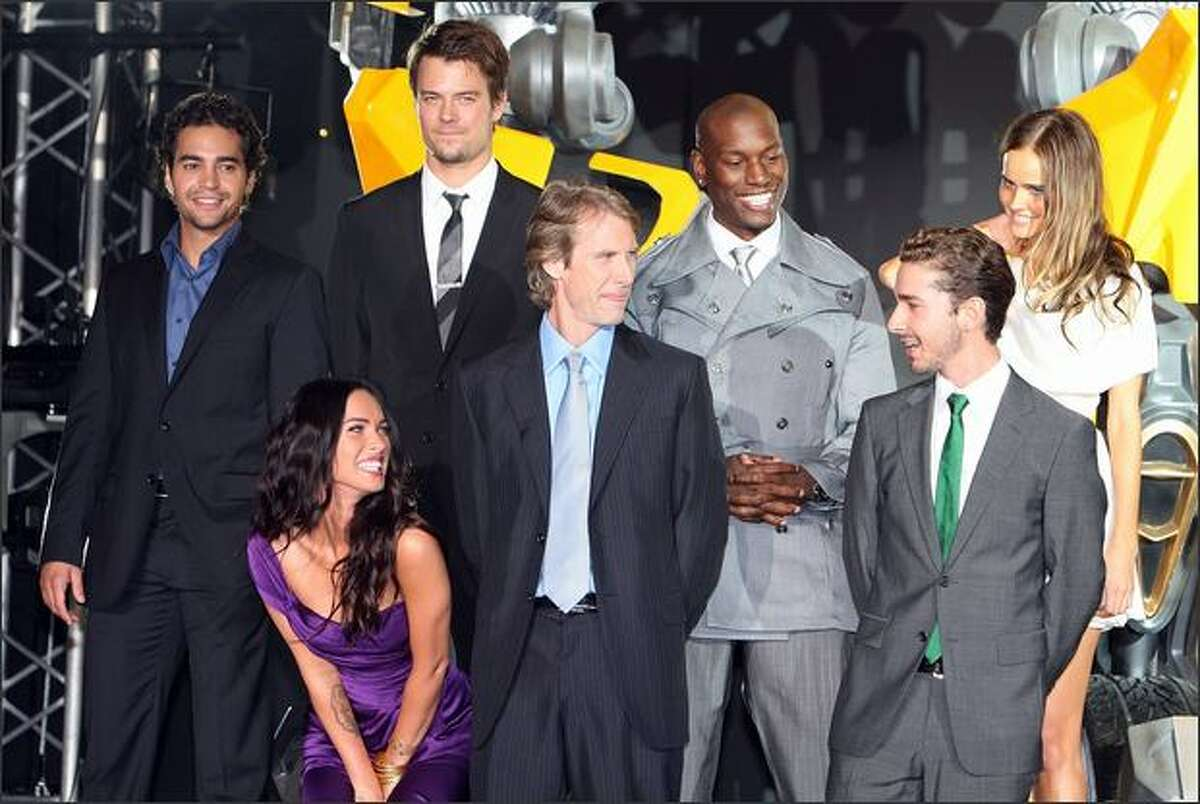 (1st row L to R) Actress Megan Fox, director Michael Bay, actor Shia LaBeouf, (2nd row L to R) actors Ramon Rodriguez, Josh Duhamel, Tyrese Gibson and actress Isabel Lucas attend the