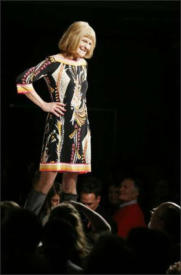 Anne Hirner models a creation in Macy's Breast Cancer Survivor Fashion Show on Saturday at the downtown Seattle Macy's. Photo: Paul Joseph Brown, Seattle Post-Intelligencer
