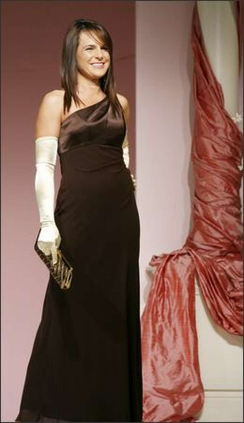 Mary Huletz models an evening gown.