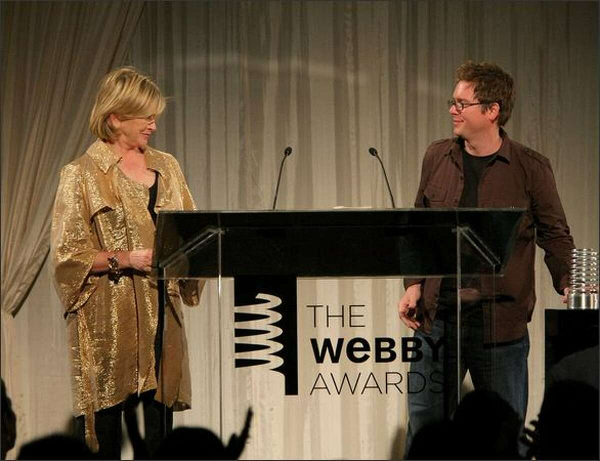 TV personality Martha Stewart presents Twitter co-founder Biz Stone with the Breakout Webby of the Year award during the 13th Annual Webby Awards at Cipriani Wall Street on Monday in New York.