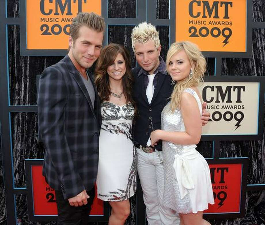 From left, musician Tom Gossin, singer Rachel Reinert, musician Mike Gossin and singer Cheyenne Kimball of Gloriana. Photo: Getty Images