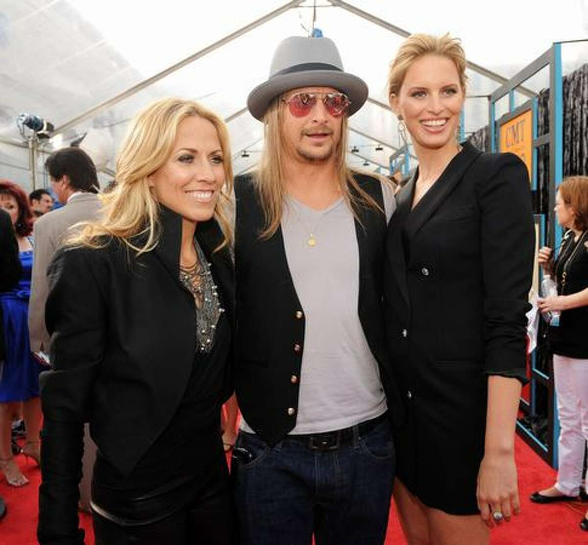 Musicians Sheryl Crow and Kid Rock and model Karolina Kurkova.