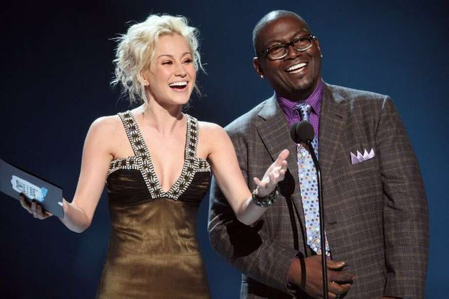 Singer Kellie Pickler and musician Randy Jackson on stage. Photo: Getty Images