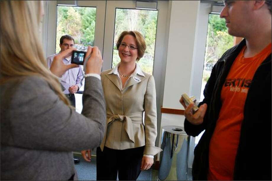 Darcy Burner votes in previous U.S. House race, and poses for picture by Joan McCarter of liberal dailykos.com web site.  McCarther and dailykos.com are boosting Burner again in 2012.