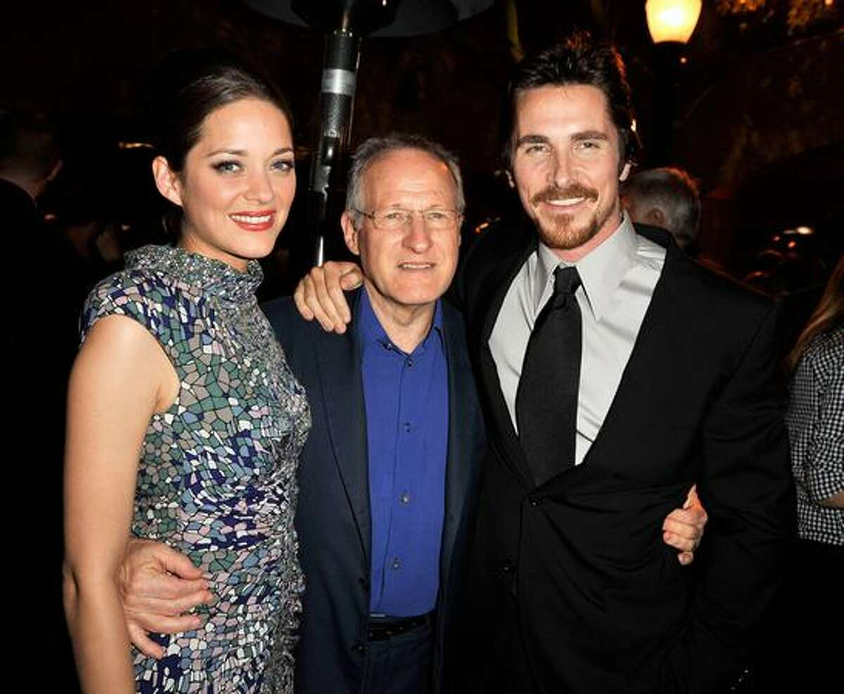 (L-R) Actress Marion Cotillard, director Michael Mann and actor Christian Bale pose at the afterparty for the premiere of Universal Pictures'