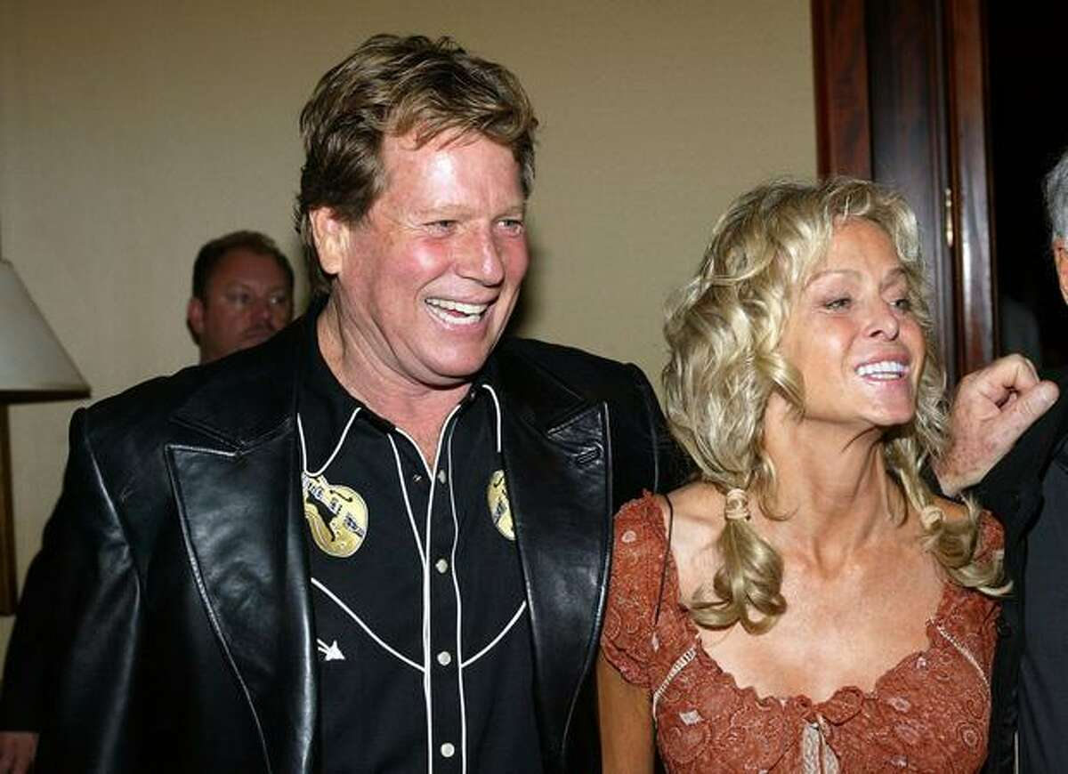 Actors Ryan O' Neal and Farrah Fawcett attend the Share, Inc., 51st Annual Boomtown Party at the Century Plaza Hotel & Spa on May 15, 2004 in Century City, California.