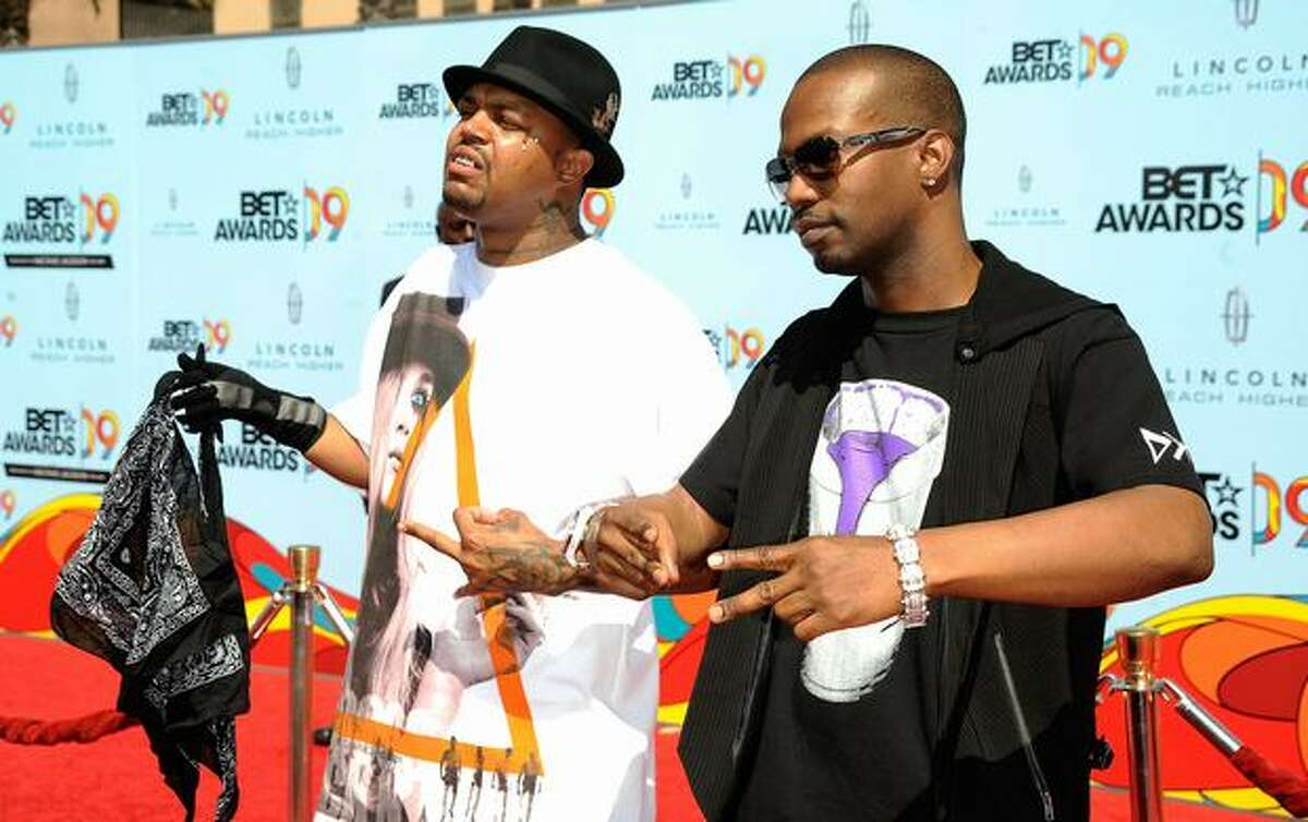 Rappers DJ Paul (L) and Juicy J of the group Three 6 Mafia arrive at the 2009 BET Awards held at the Shrine Auditorium on Sunday in Los Angeles, California.