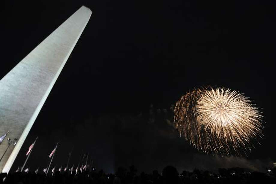 People watch fireworks at the National Mall in Washington as part of the July 4 celebrations. Photo: Getty Images