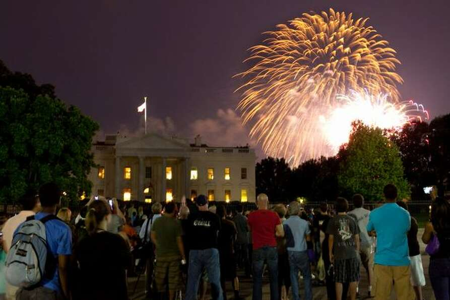 Fireworks explode over the White House.