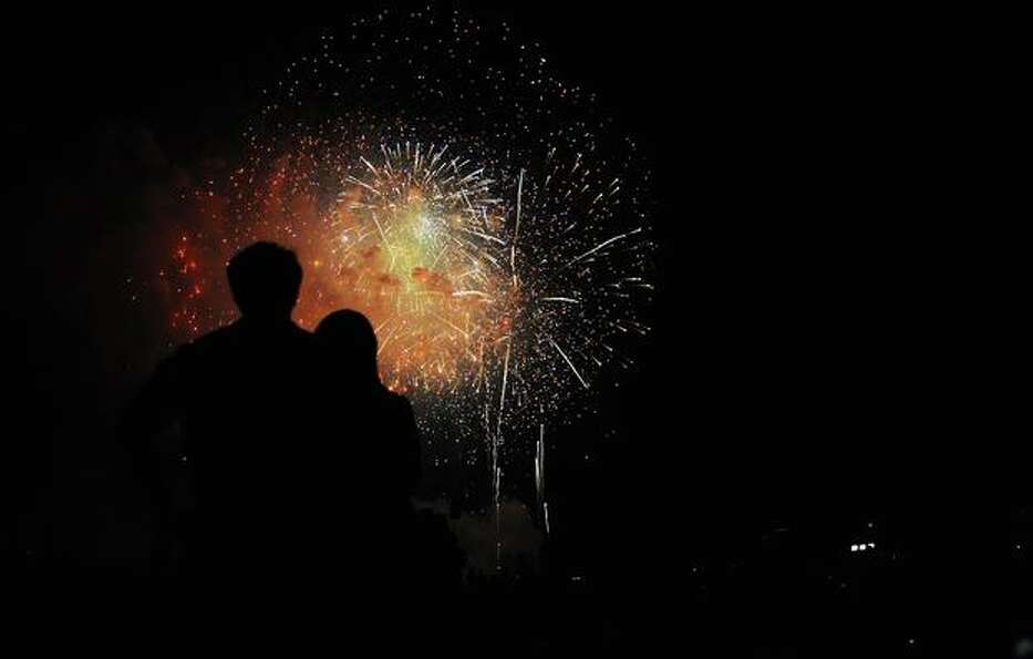 People watch fireworks at the National Mall.