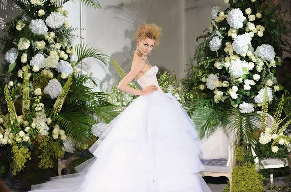 A model walks down the runway during the Christian Dior Haute Couture fashion show in Paris, France.