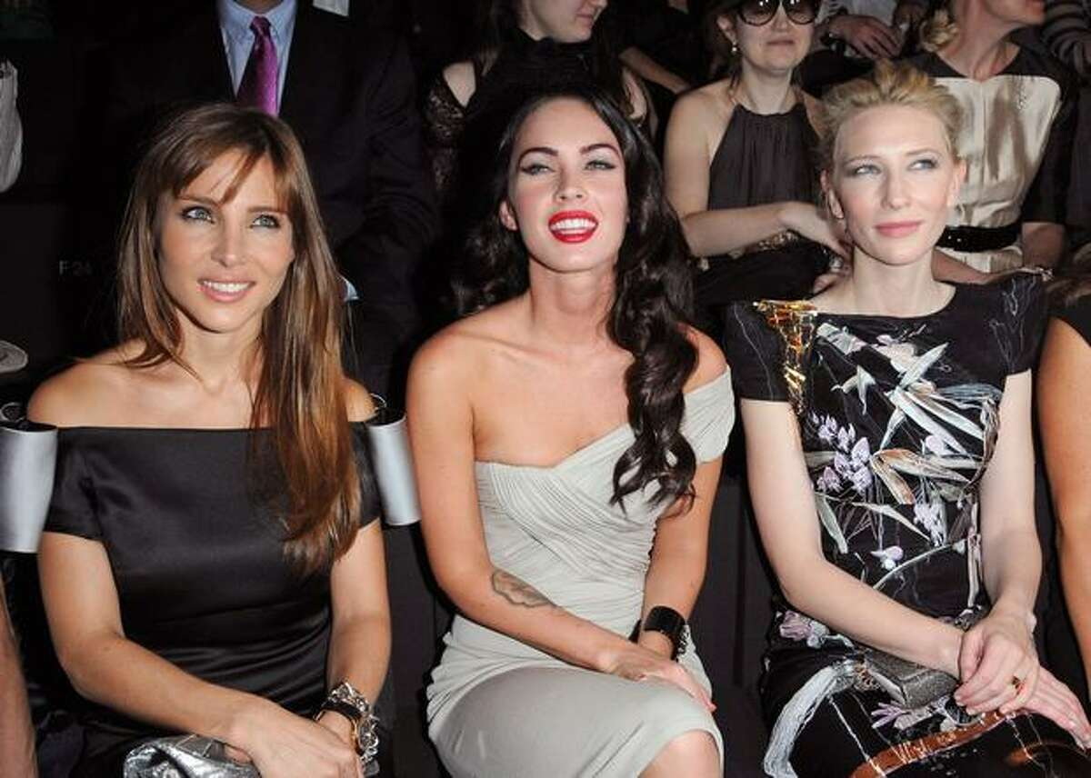 From left, actresses Elsa Pataky, Megan Fox and Cate Blanchett attend the Giorgio Armani Prive fashion show.