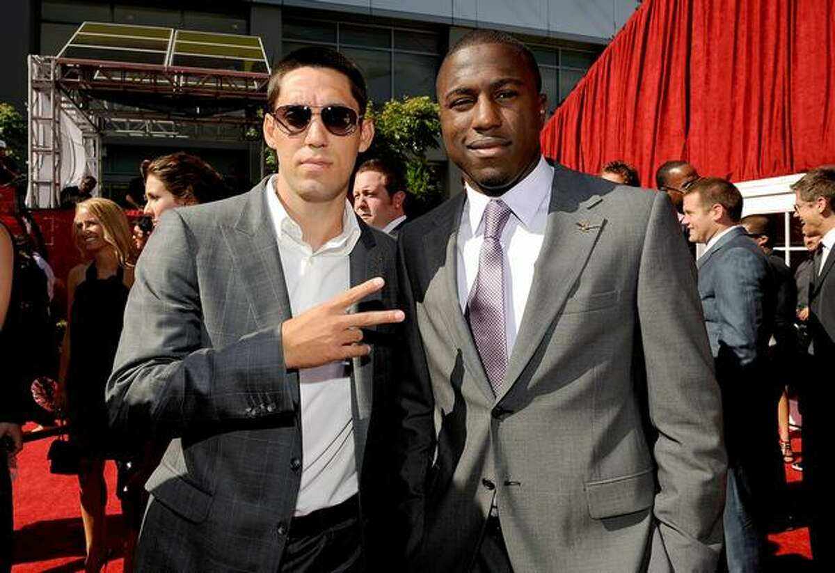 U.S. national soccer team players Clint Dempsey (left) and Jozy Altador arrive.