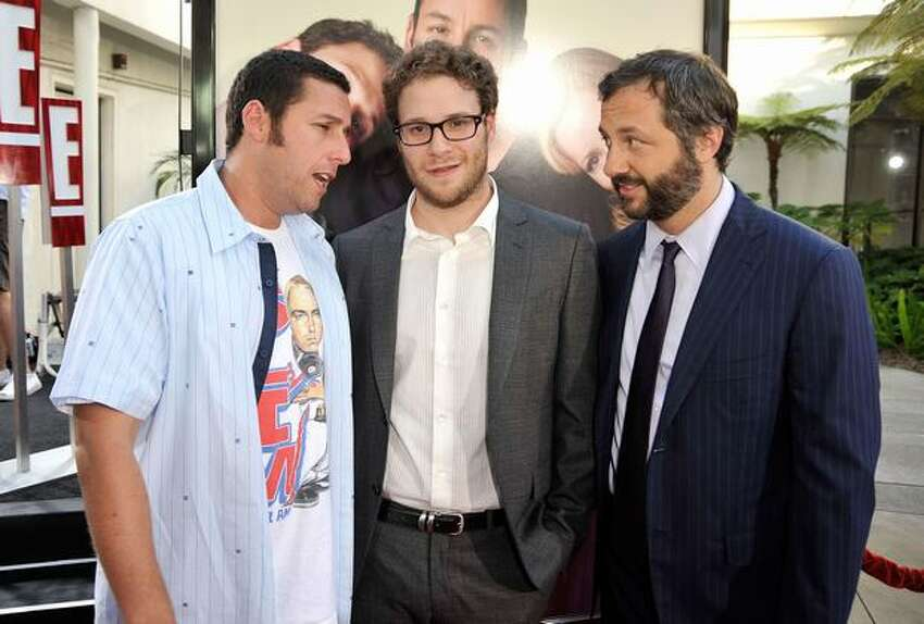 (L-R) Actor/executive producer Adam Sandler, actor Seth Rogen and director/writer/producer Judd Apatow attend the premiere of Universal Pictures'