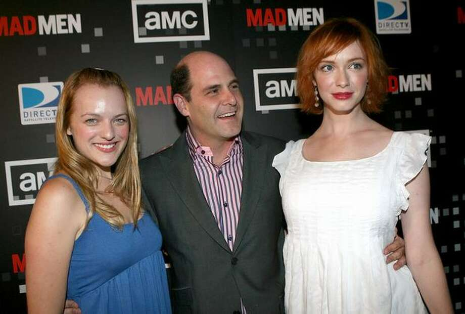 "Actress Elisabeth Moss (""Peggy""), producer Matthew Weiner and Hendricks attend the wrap party for ""Mad Men's"" first season in Hollywood, Aug. 24, 2007. Photo: Getty Images"