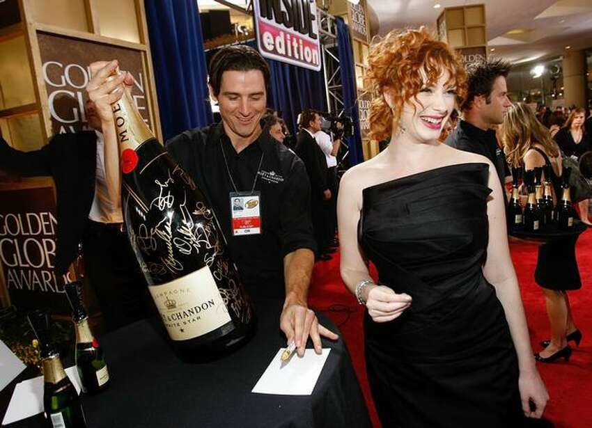 Hendricks signs a champagne bottle at the 66th Golden Globe Awards in Beverly Hills, Jan. 11, 2009.