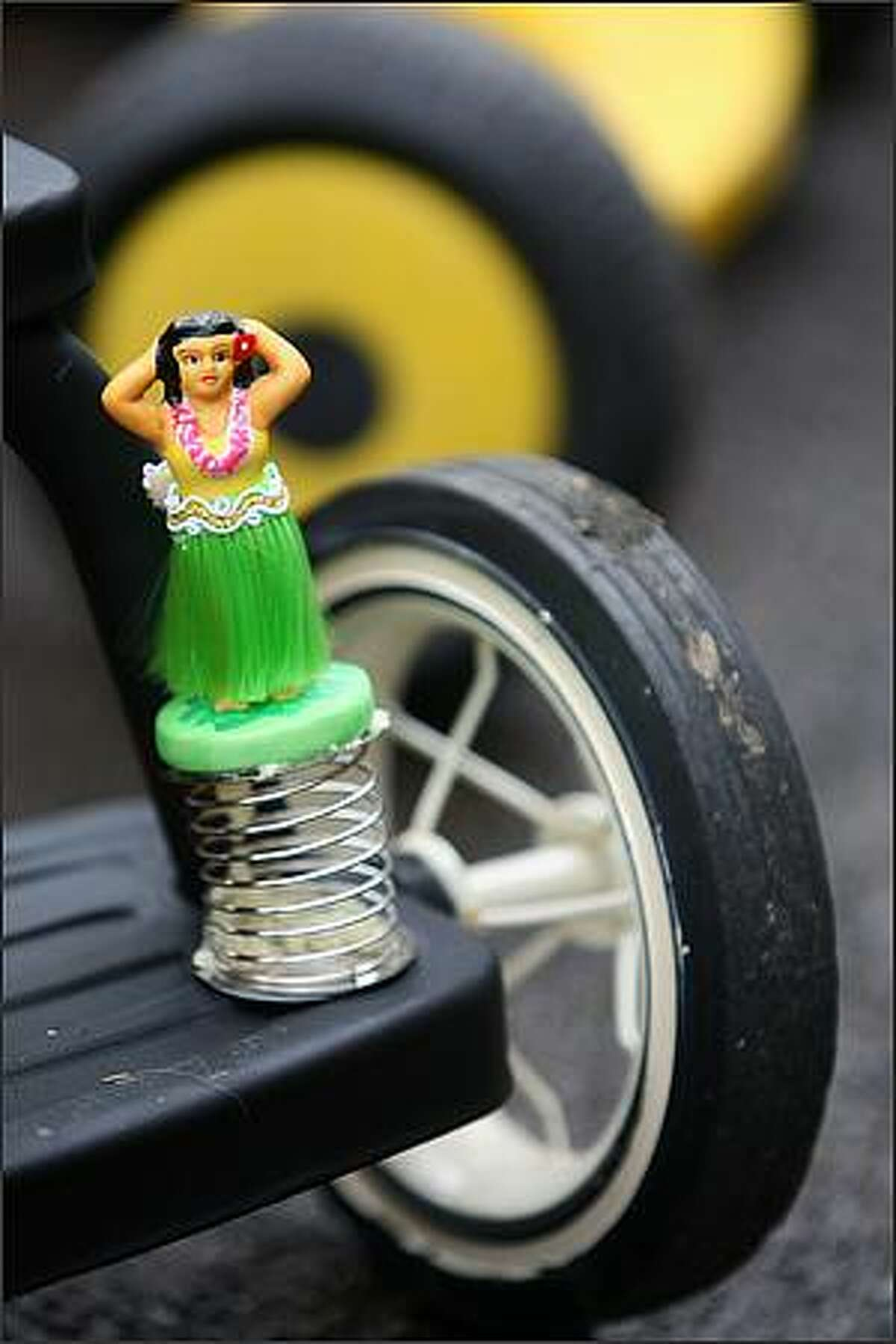 A tricycle is accessorized at the beginning of the Queen Anne Tricycle Race on Sunday in Seattle.