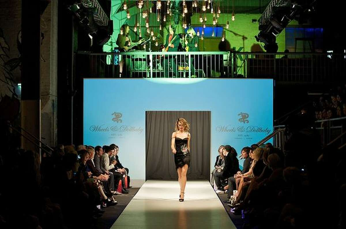 A model showcases a design on the catwalk by Wheels & Dollbaby.