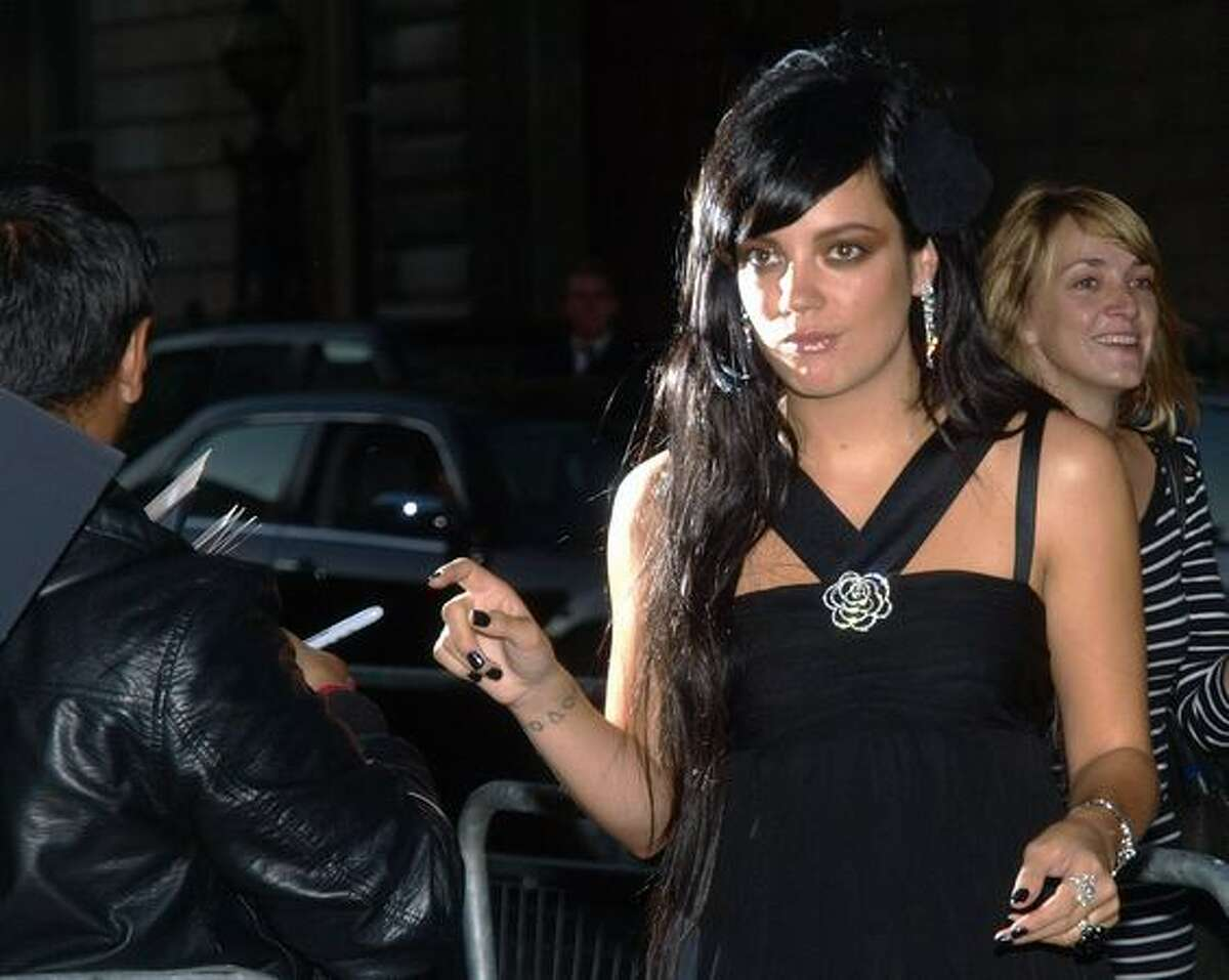 British singer Lily Allen arrives for the GQ Awards at the Royal Opera House, London.