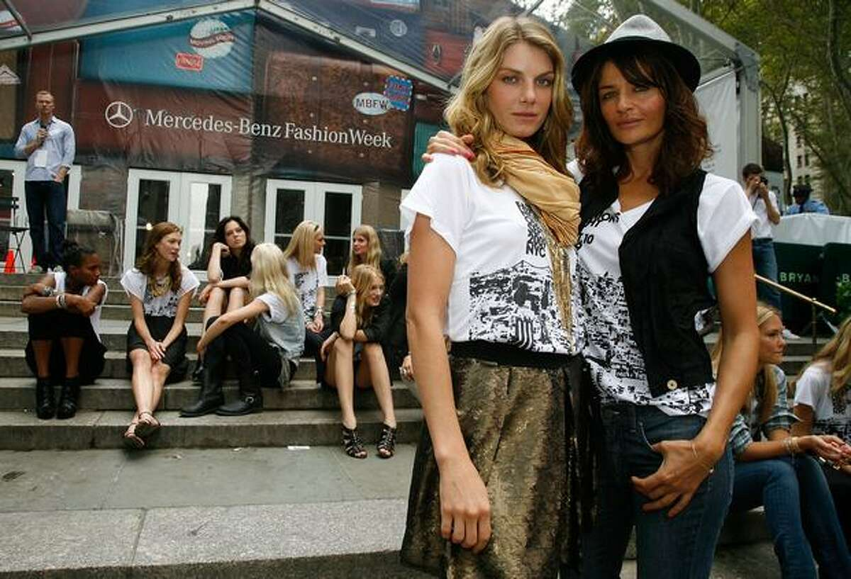 Models Angela Lindvall (left) and Helena Christensen pose during the Bryant Park preparation.