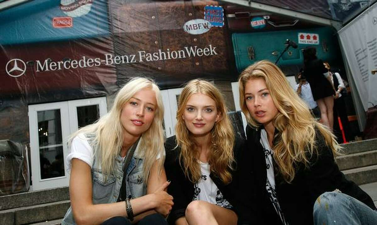 From left, models Raquel Zimmermann, Lily Donaldson and Doutzen Kroes pose during the Bryant Park preparation.