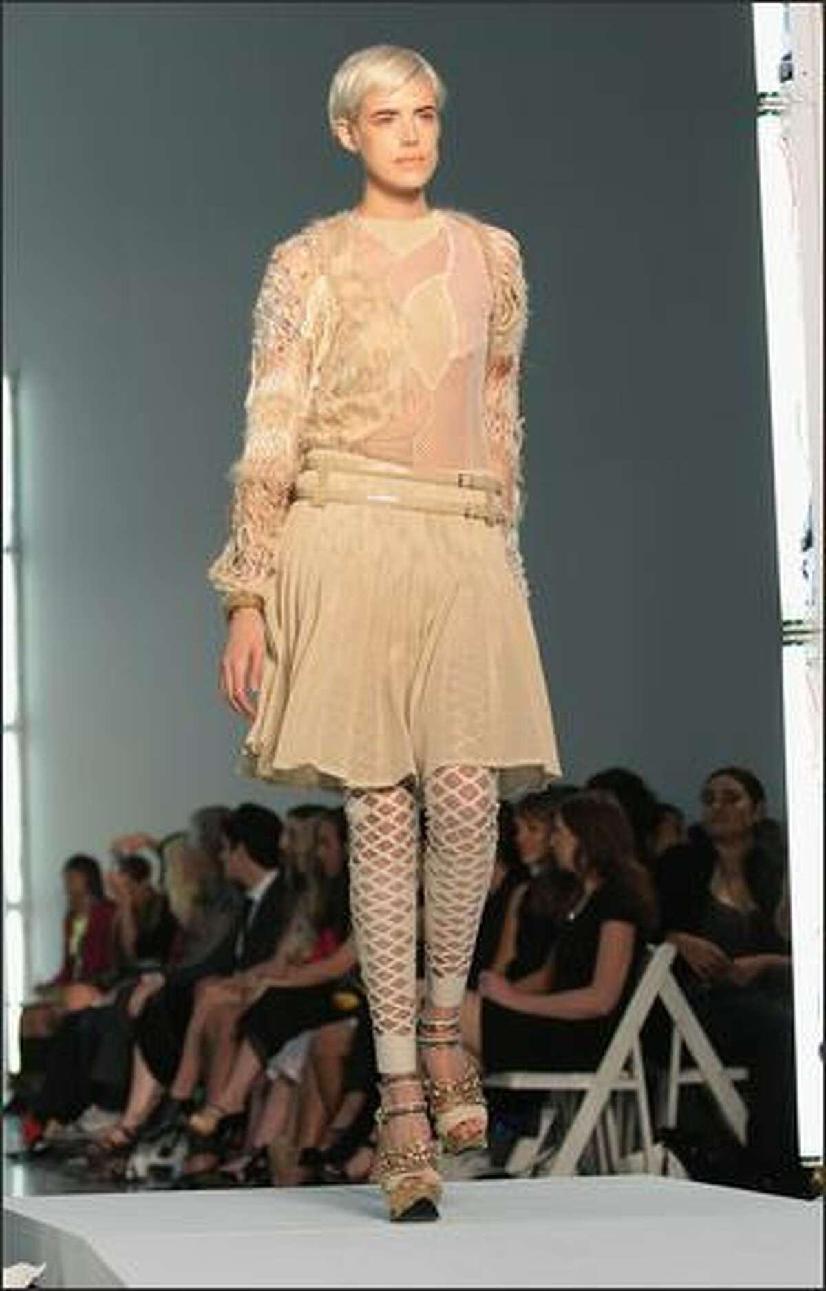 A model walks the runway at the Rodarte show.