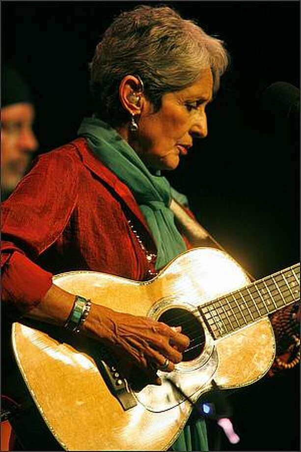 "Joan Baez plays The Moore Theater in Seattle to promote her twenty-fourth studio album ""Day After Tomorrow"" produced by Steve Earle. This year, 2008, marks Baez's 50th year as a performer. Photo: Mike Urban, Seattle Post-Intelligencer"