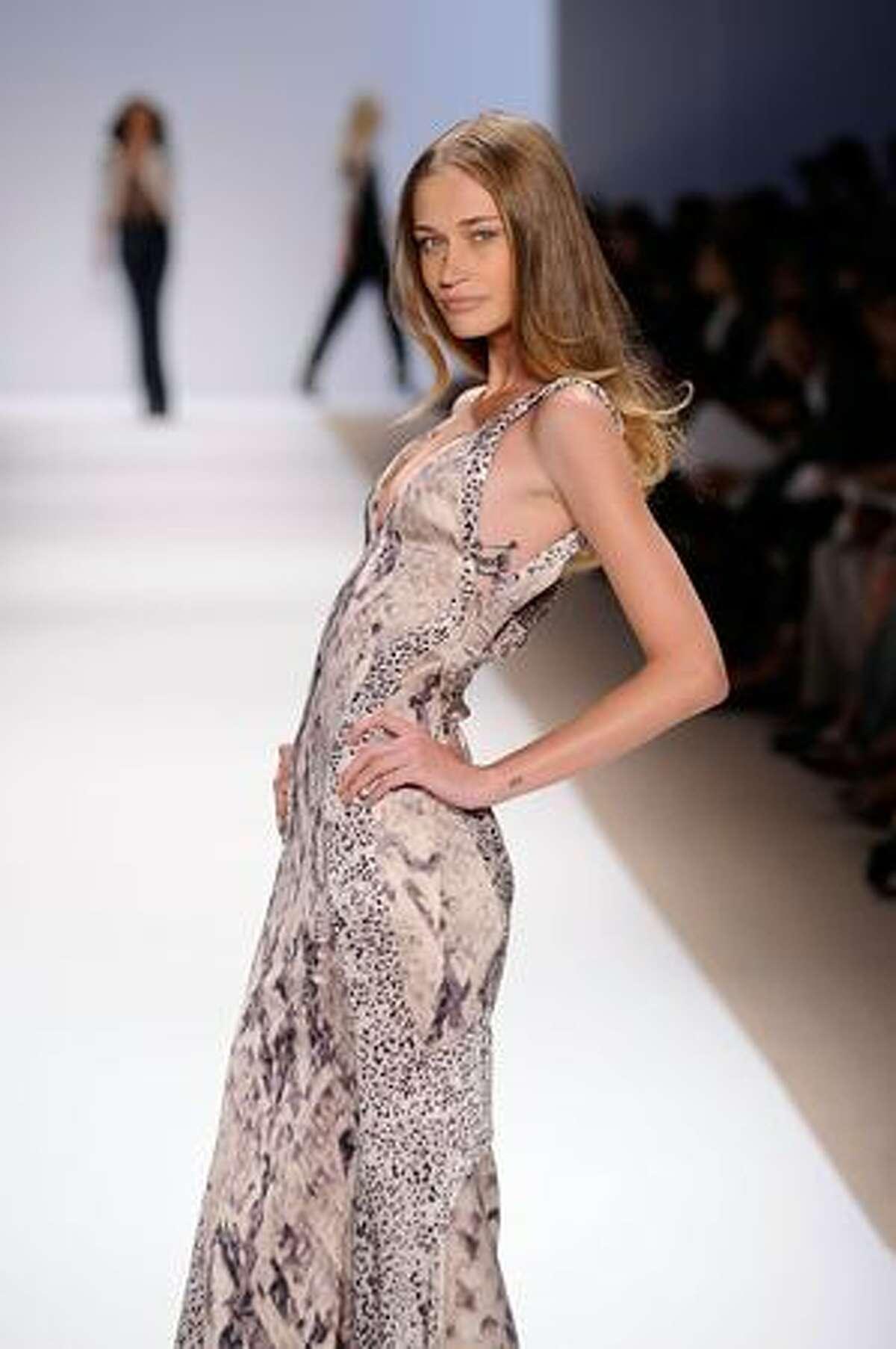 A model walks the runway at Carlos Miele Spring 2010 fashion show at the Promenade at Bryant Park in New York, New York.