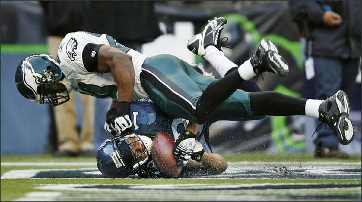 Seattle wide receiver Keary Colbert is unable to hold onto a pass in the end zone as Philadelphia safety Brian Dawkins lands on top of him in the third quarter at Qwest Field.DeLong: The 2008 Seahawks will be partly remembered for their revolving door of injured receivers. In this image, Keary Colbert -- cut 10 days after this game -- can't maintain control of the ball as he slides across the end zone, with the Eagles' Brian Dawkins on top.