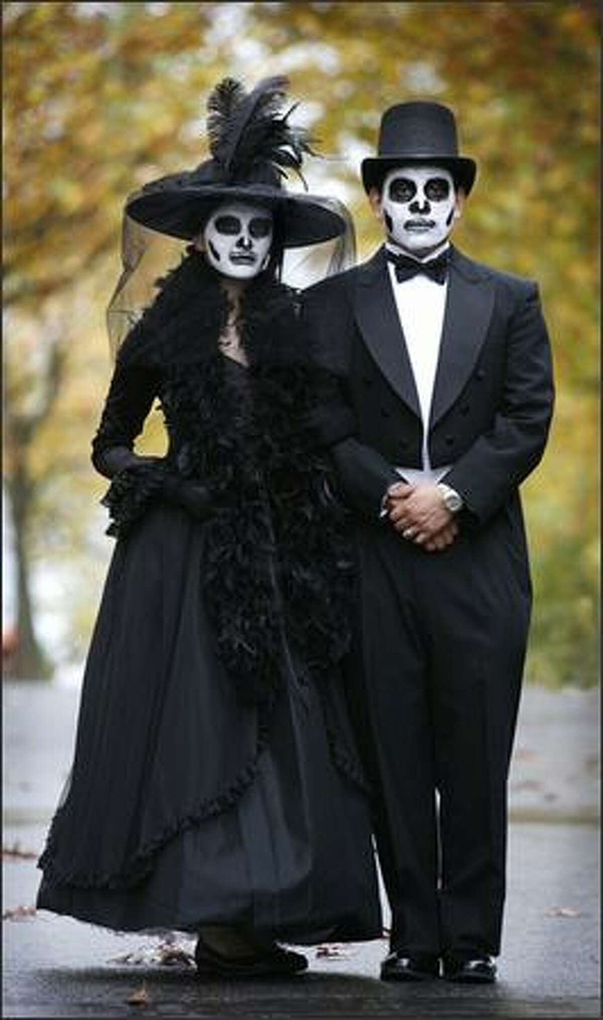 Zulley Diaz and Joel Mercado attend Dia de Muertos celebrations at Seattle Center properly attired. Brown: These real-life young sweethearts had a natural elegance about them, strolling about hand-in-hand dressed and made up as dead lovers from early in the previous century.