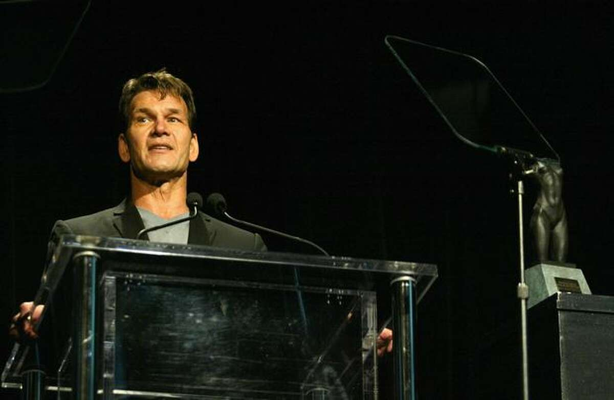 Actor Patrick Swayze speaks on stage during the Rodeo Drive Walk Of Style Award Show on March 20, 2005 in Beverly Hills, Calif.