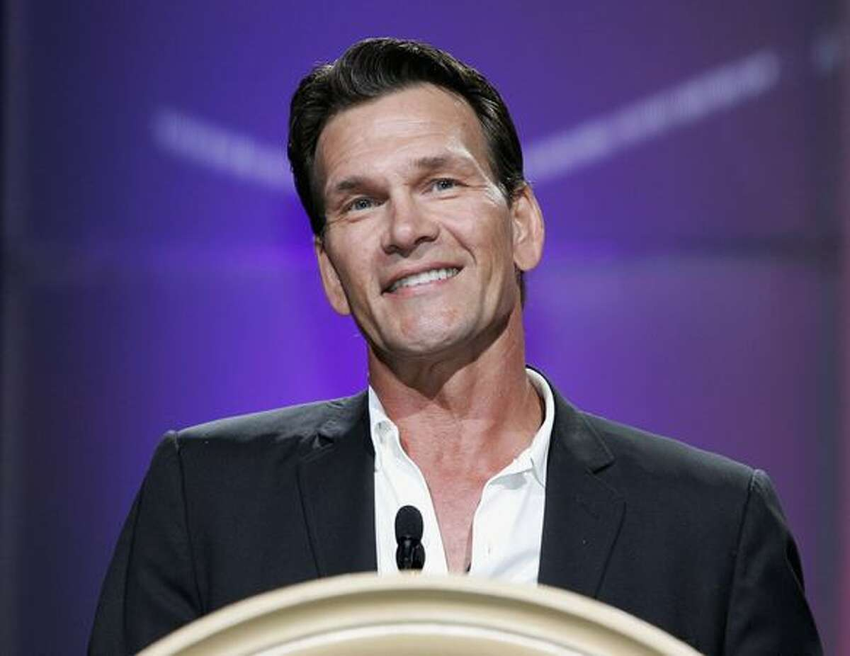 Actor Patrick Swayze accepts the Independent Career Achievement Award at the Video Software Dealers Association's award show July 27, 2005 in Las Vegas.