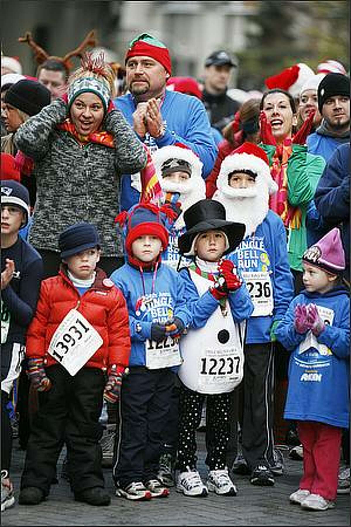 Runners of all ages wait for the start of the Children's 1K Run.