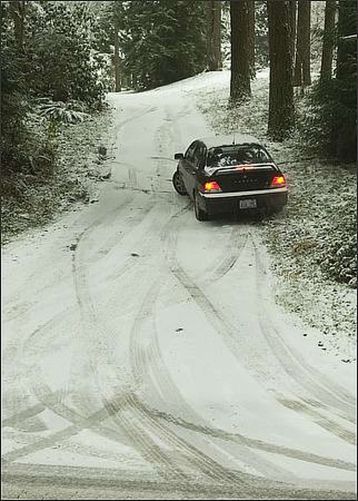 A driver failed to get up a private road off Butternut Road in south Snohomish County on Thursday. He decided to park the car down the road and walk in.