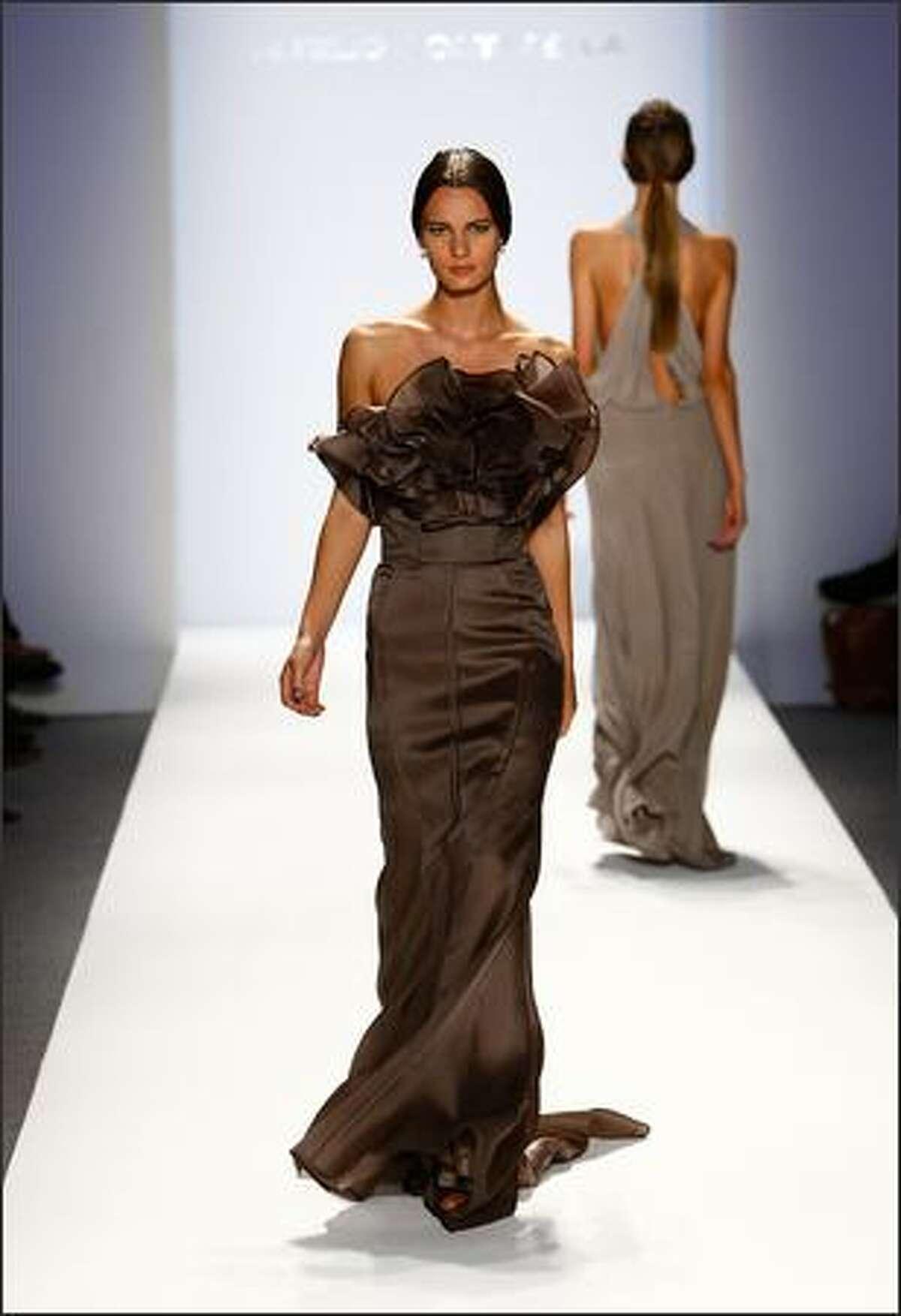 A model walks the runway at the Aurelio Costarella show.
