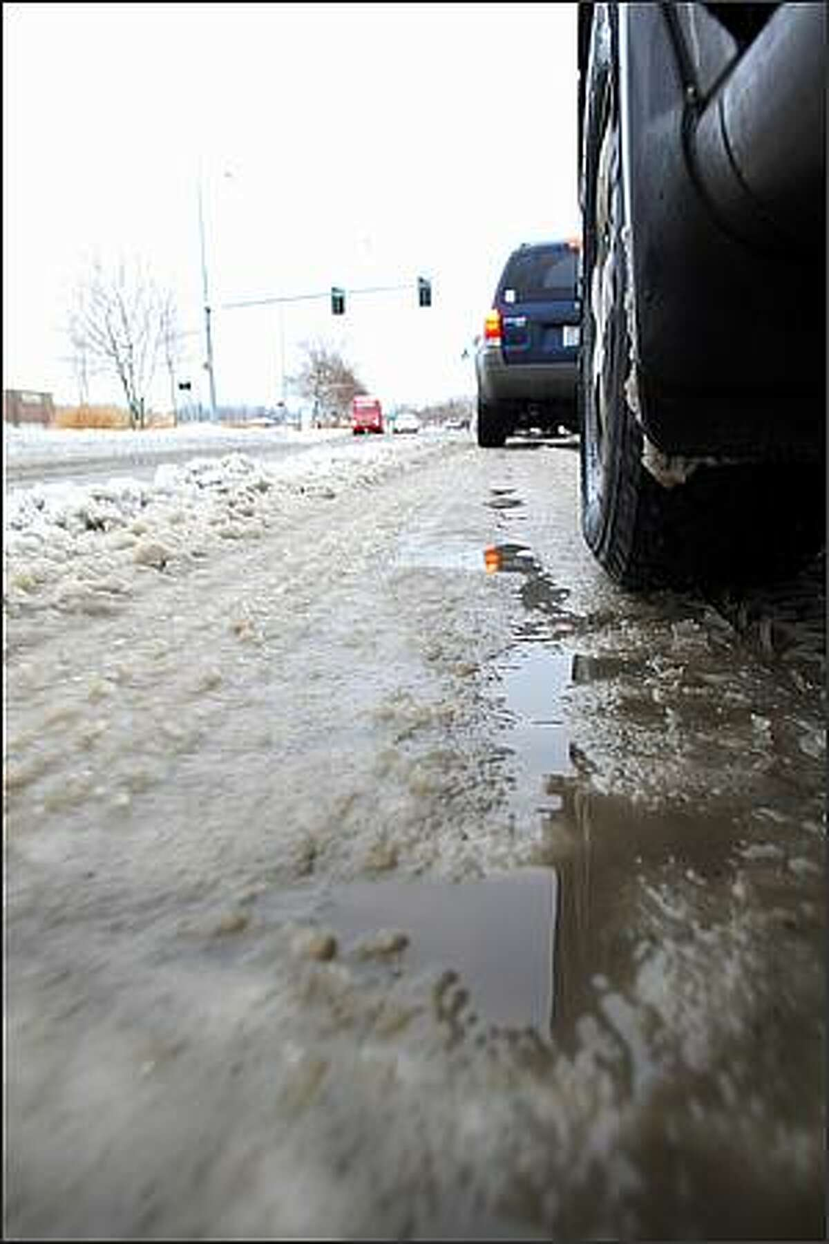 Roads of partly melted ice clumps lead the way into Alderwood Mall in Lynnwood, Wash.