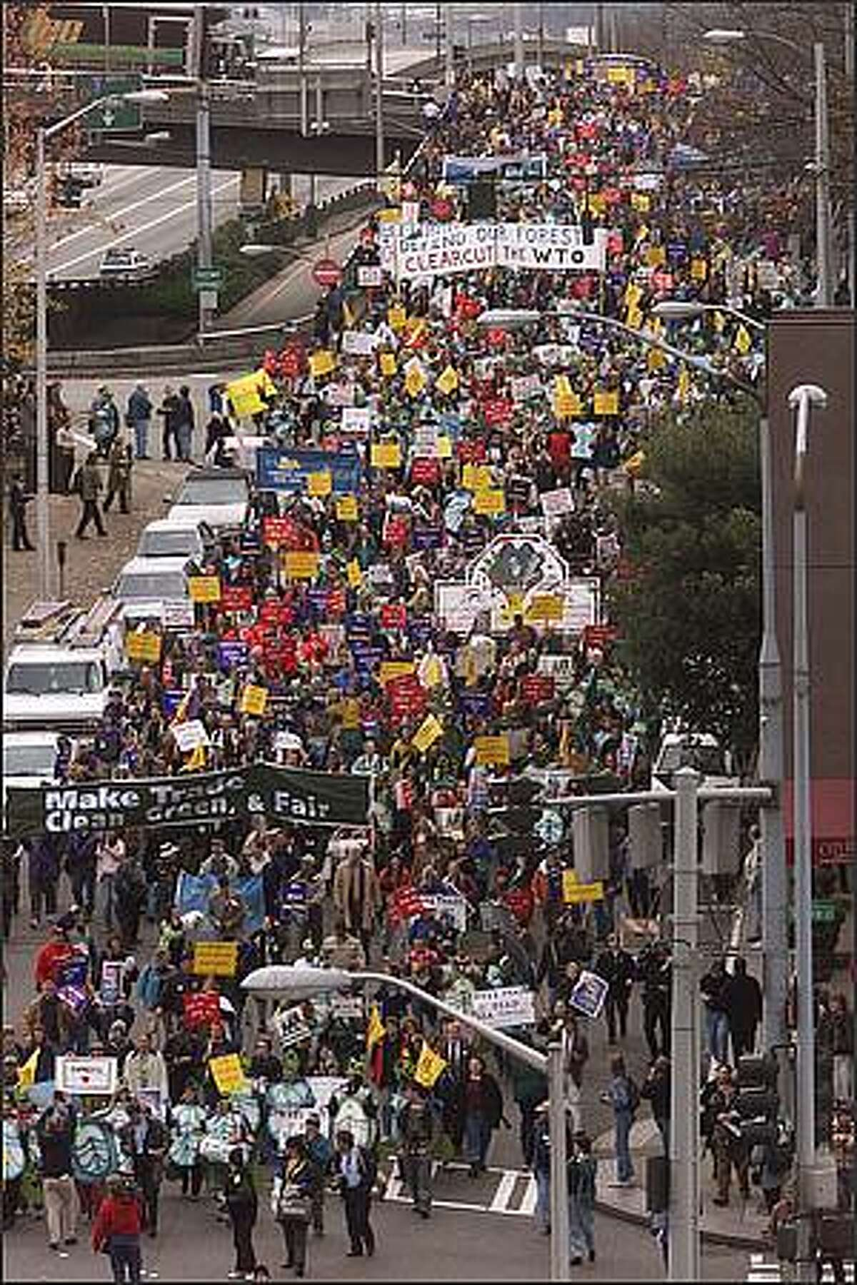 WTO protesters march down sixth avenue from Marion on thier way to the Convention Center. Photo by Mike Urban/Seattle Post-Intelligencer