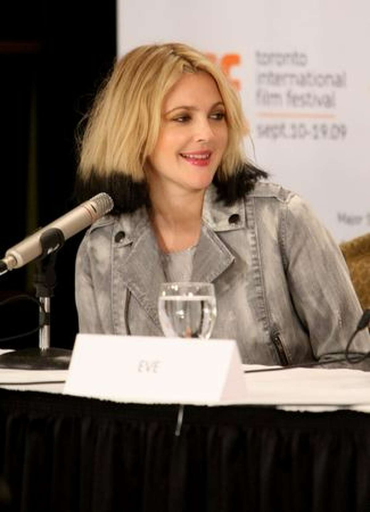 """Director Drew Barrymore speaks onstage at the """"Whip It"""" press conference held at the Four Seasons Hotel in Toronto, Canada."""