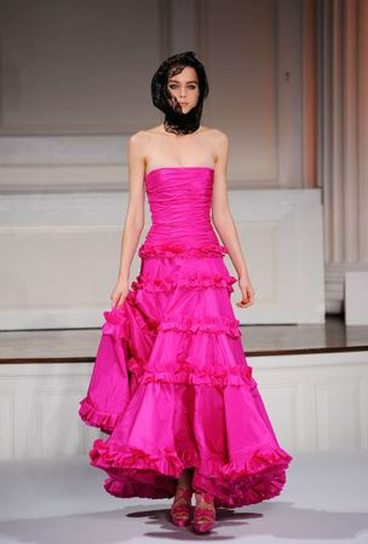 A model walks the runway at Oscar De La Renta Spring 2010 fashion show at 583 Park Avenue in New York City.