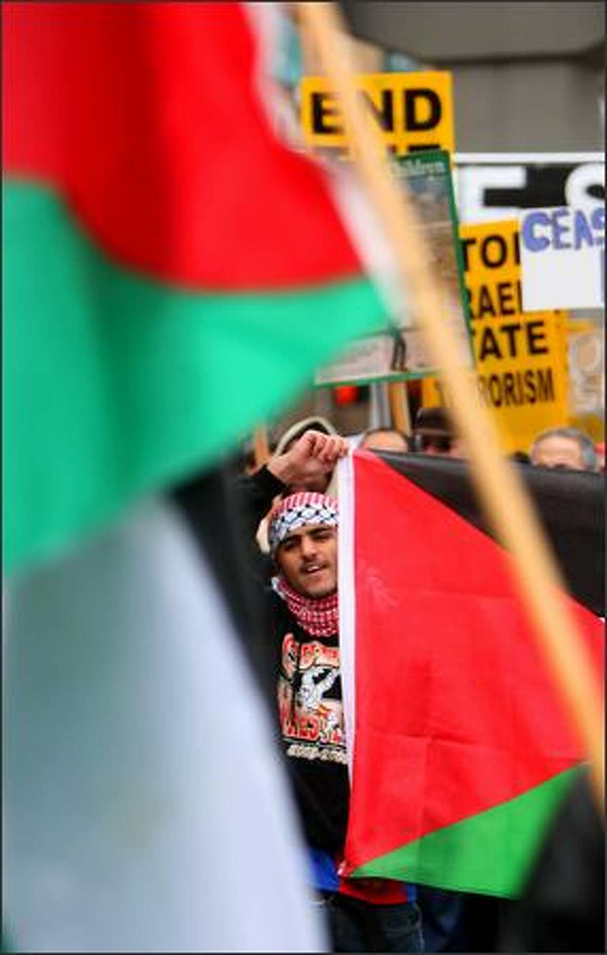 Hussain Al-Dabashi of Tacoma joins other supporters of Palestine in a march through downtown.